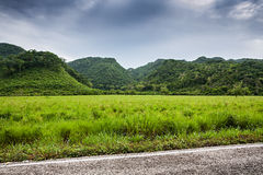 Green fields and mountains with moody sky before rain. In Mexico region , Chiapas Stock Images