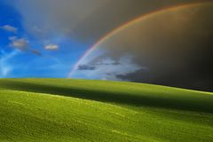 Green hills and rainbow background Royalty Free Stock Photos