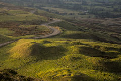 Green Fields of Peak District. And a road near Edale Stock Photo