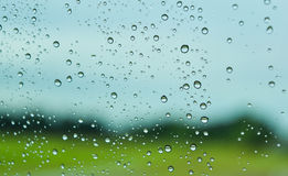 Green fields after rain behind the window, look fresh, relax, calm and quiet. Stock Photo