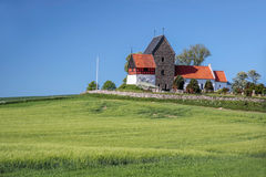Green fields by the Ruts Kirke church on Bornholm Royalty Free Stock Photos