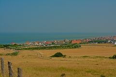 Green fields and small village on the French Opal North Sea coast. Green fields and small village of Sangatte on the Opal North Sea coast, Nord Pas de Calais royalty free stock image