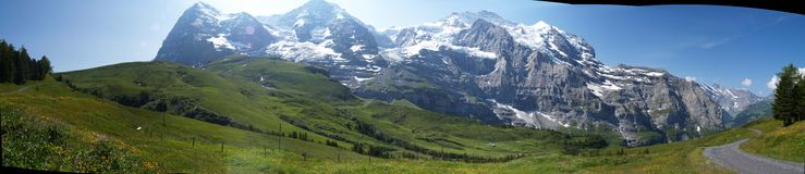 Green fields and swiss alps Royalty Free Stock Photos