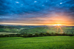 Green fields in the valley at sunset, Tuscany Royalty Free Stock Photography
