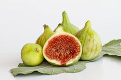 Green figs on fig leaf. Freshly picked green figs on fig leaf royalty free stock photos