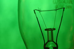 Green filament. A light bulb filament on a green background Stock Photography