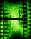 Green filmstrip. Grunge green filmstrip with some spots and stains on it Stock Photo