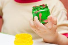 Green fingerpaint Stock Photos