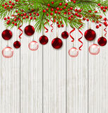 Green fir branch and red decorations. Christmas card with green fir branch and red decorations on a wooden background. Vector illustration Royalty Free Stock Image