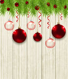 Green fir branches and red baubles Stock Photo
