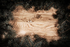 Green fir branches on the wooden floor Stock Images