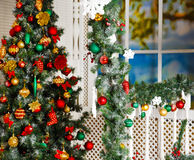 Green fir-tree with red and gold Christmas toys Royalty Free Stock Images