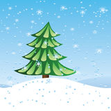 Green fir tree on slope. Winter holiday scene with green fir tree over blue snowing background Stock Photos