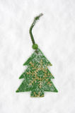 Green fir tree toy on snow Stock Photo