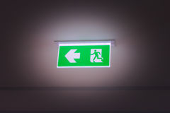 Green fire exit light sign Stock Photography