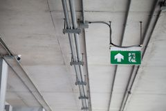 Fire Exit sign in building Stock Images