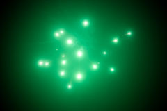 Green fireworks background Stock Photos