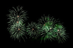 Green fireworks. Celebrating the New Years Eve with colorful fireworks show Stock Photo