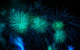 Green fireworks display. Celebrating holidays with colorful fireworks display. Happy New Year 2017 greeting card. Happy Independence Day. Success celebration Royalty Free Stock Image