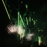 Green fireworks over black sky Stock Photography