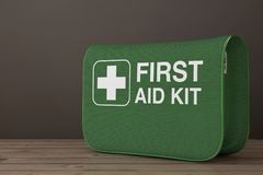 Green First Aid Kit Soft Bag with White Cross. 3d Rendering. Green First Aid Kit Soft Bag with White Cross on a wooden table. 3d Rendering Royalty Free Stock Photos