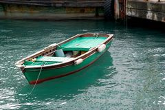 Green fishing boat. A small vessel propelled on water by oars, sails, or an engine Royalty Free Stock Photo