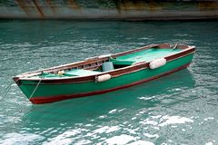Green fishing boat. A small vessel propelled on water by oars, sails, or an engine Stock Image