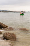 Green fishing boat thai on the sea Stock Images
