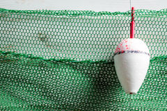 Green fishing net with floats Royalty Free Stock Images
