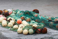 Green fishing net with spherical buoys Royalty Free Stock Photos
