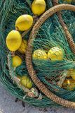 Green fishing net with yellow floating balls and thick rope stock images