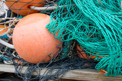 Green Fishing Nets with Orange Buoy Float. Lie on a dock Stock Photography