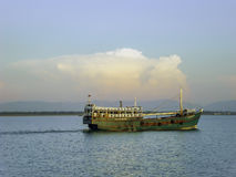 Green fishing trawler on the Naf river, Bangladesh. I was traveling to St. Martin Island in Bangladesh by ship. When we were at the Naf river, I saw this green Royalty Free Stock Image