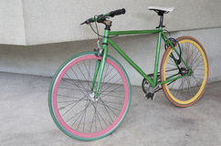 Green fixed gear bicycle at building. Retro Royalty Free Stock Images