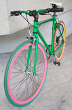 Green fixed gear bicycle at building. Retro Royalty Free Stock Photos
