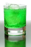 Green fizzy drink with ice cubes. Royalty Free Stock Photos