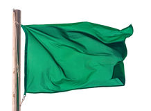 Green flag against white Stock Photos