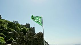 A green flag with arabic text Stock Image