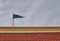 Green flag on the roof Stock Photos