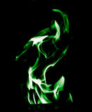 Green flame of fire on a black background Stock Photo