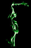 Green flame of fire on a black background Stock Images