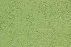 Green flat rough painted cement wall with many cavities. Seamless texture. Used as a background. Copy space for your text stock photography