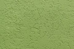 Green flat rough painted wall with many cavities. Seamless texture. Used as a background. royalty free stock photography