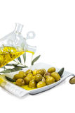 Green flavors on the plate. The magical flavor of olives Royalty Free Stock Images