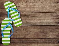 Green flip flop sandals on wooden boards. Green flip flop sandals on old wooden boards Stock Photo