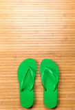 Green Flip Flops on Bamboo Mat With Copy Space Stock Photos