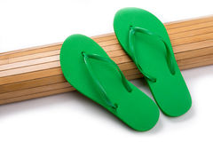 Green Flip Flops on Bamboo Mat With Copy Space Royalty Free Stock Photos