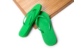 Green Flip Flops on Bamboo Mat Royalty Free Stock Photography