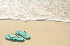 Green Flip Flops on Beach. Green Flip Flops on a Sandy Beach Royalty Free Stock Photo