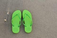Green flip-flops Stock Image
